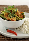 Vegetable curry in small bowl, with rice