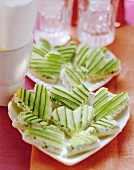 White bread hearts with soft cheese & cucumber slices for party