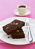 Two pieces of chocolate banana cake and cup of coffee