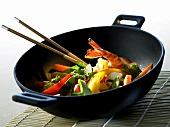 Wok-cooked dish with shrimps and vegetables