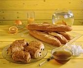 Baguettes, chocolate rolls, fresh orange juice and honey