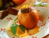 Baked apple with date filling and orange sauce
