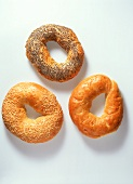 Three different bagels (sesame, poppy seed, plain)
