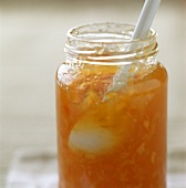 China spoon in a jar of Seville orange marmalade