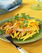 Mango salad with strips of smoked haddock