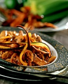 Strips of pork with onions and aubergines