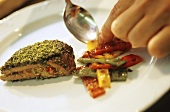 Stuffed lamb steak with herb crust and peppers