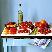 Various varieties of tomatoes on a kitchen table