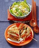 Chicken salad with lemon mayonnaise & muffuletta sandwich (USA)