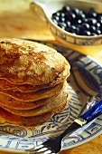 A pile of blueberry pancakes