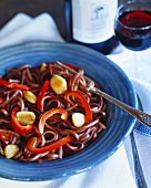 Fettuccini cooked in red wine with peppers and garlic