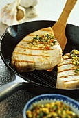 Fried tuna steaks in grill pan