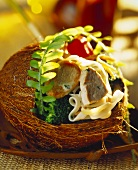 Pork fillets with ribbon pasta and vegetables in a coconut