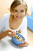 Young woman with fresh berry muesli