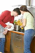 Young couple cooking spaghetti together