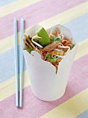 Rice noodles with tuna and vegetables in a take-away box