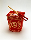 Asian take-away box and chopsticks