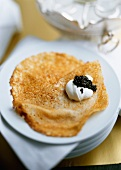 Blini s ikroi (blinis with sour cream and caviare, Russia)