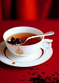 Tea with varen'ye (fruit jam, Russia)