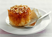 Steamed pudding with apricots and coconut flakes