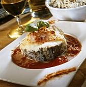 Haddock steak with gratin topping on tomato sauce