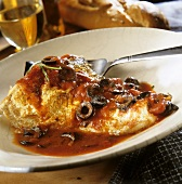 Gilthead bream with olive and tomato sauce