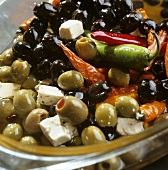 Pickled green and black olives, sheep's cheese and chillies