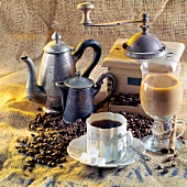 Still life with coffee, old coffee mill and coffee pots