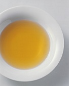 Clear broth in plate