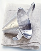 Conical sieve on kitchen cloth