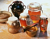 Several honey jars and dish of honey