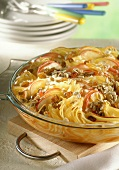 Pasta bake with apples, sunflower seeds and raisins