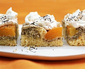 Three pieces of apricot with poppy seeds and cream