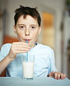Boy drinking milk through straw