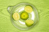 Limes in citrus squeezer