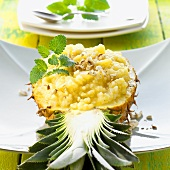 Pineapple rice with nuts in a pineapple half (Thailand)