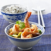 Fried shrimps with vegetables and a bowl of rice (China)