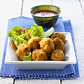 Deep-fried shrimp balls with chili sauce (Indonesia)