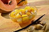 Bottled pumpkin with vanilla and almonds in small glass bowl