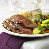 Four slices of roast beef with potato salad & Brussels sprouts