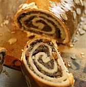 Poppy seed roll with a piece cut