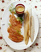 Marinated salmon with honey and mustard sauce and baguette