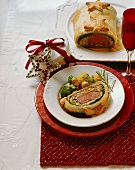 Veal fillet in puff pastry with broccoli and potatoes