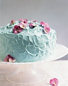 Turquoise butter cream cake decorated with pansies