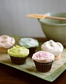 Several coloured cup-cakes