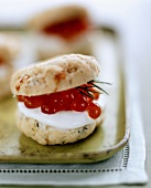 Herb scone filled with soft cheese and salmon caviare