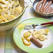 Vegetarian sausages with potato salad