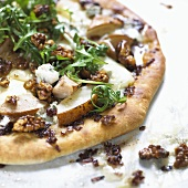 Pizza with nuts, pear, gorgonzola and rocket