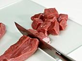Cutting veal goulash