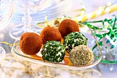 Six seasoned feta balls in a glass dish